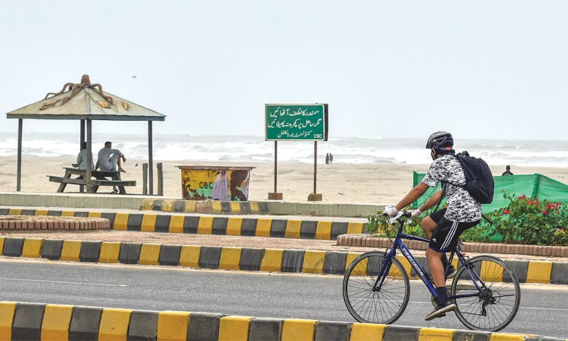 A cyclist peddles by the deserted Seaview beach on Friday.—White Star