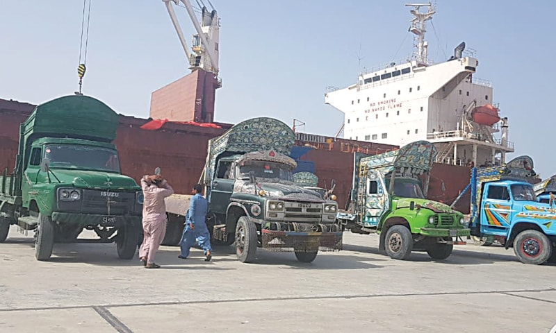 TRUCKS line up at Gwadar Port before fertiliser is unloaded from the ship on Friday.—Dawn