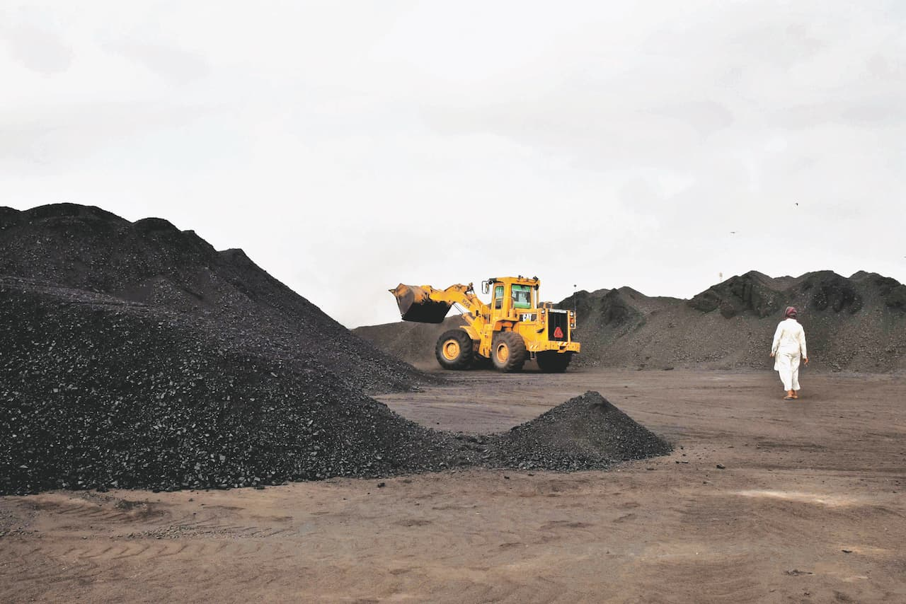 Coal being unloaded in Landhi, Karachi | Fahim Siddiqi, White Star