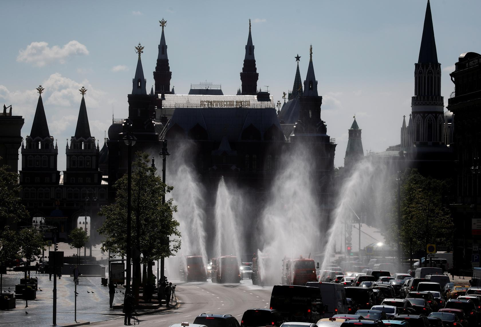 Vehicles spray disinfectant while sanitising a road in Moscow, Russia, May 28. — Reuters