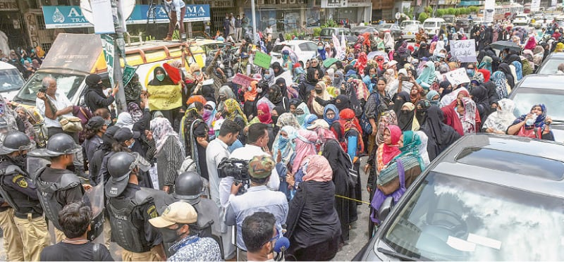 POLICE stop protesting dismissed community-based polio vaccinators from marching on the Governor House to seek the restoration of their services on Monday. —Fahim Siddiqi/White Star