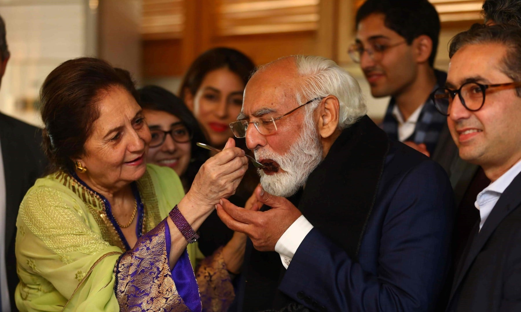 This handout picture taken on March 26, 2020, and received as a courtesy of the Adil Rahman family shows Fazal Rahmaan (2R) celebrating his 80th birthday with his wife Wahida Fazal Rahmaan in Lahore. — AFP/File