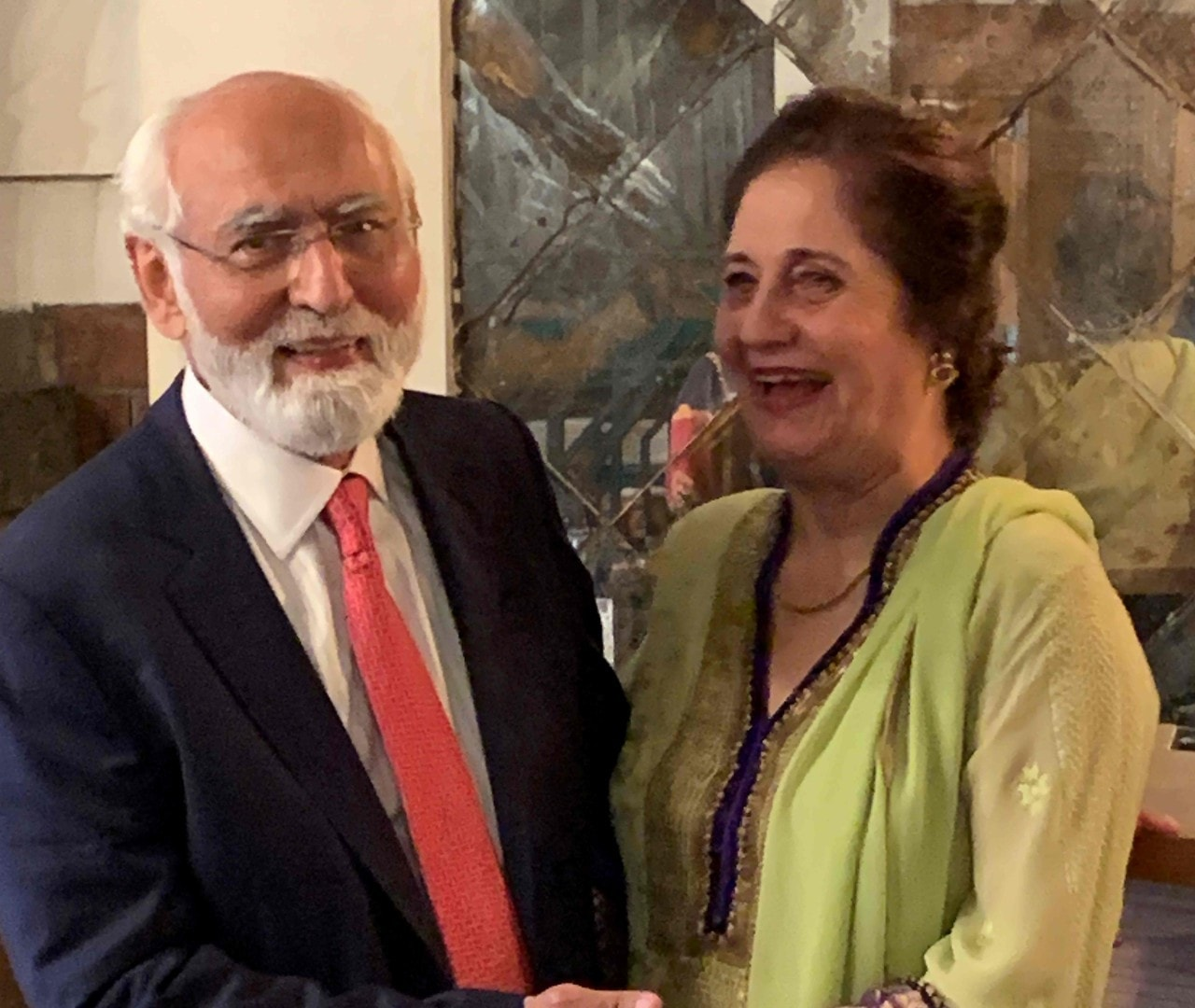 This handout picture taken on March 26 and received as a courtesy of the Adil Rahman family shows Fazal Rahmaan celebrating his 80th birthday with his wife Wahida Fazal Rahmaan in Lahore. — AFP