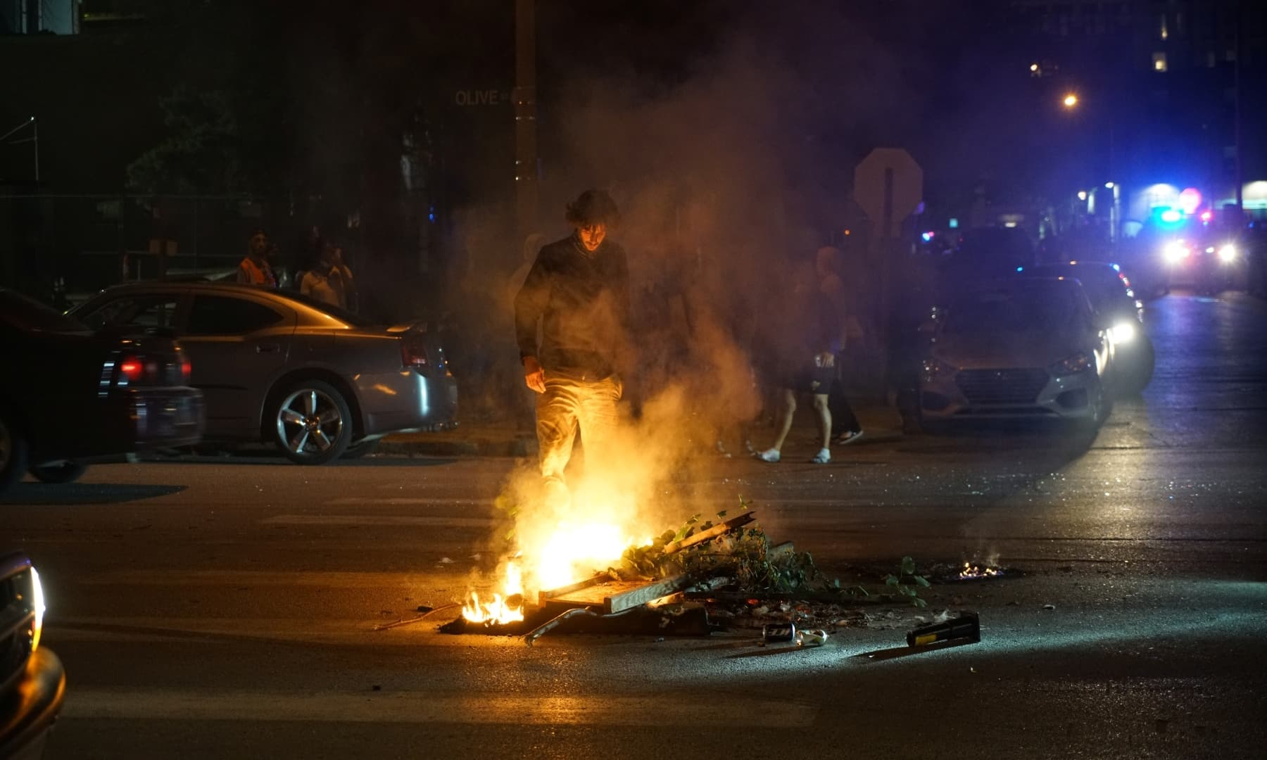 A protestor stands near a fire on the street during a protest in St Louis, Missouri, on June 2. — Reuters