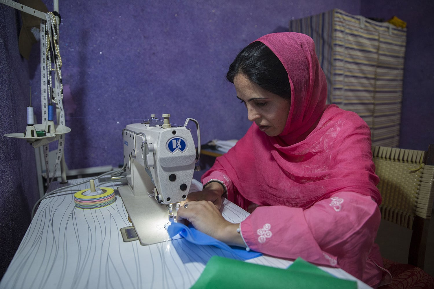33-year-old Nusrat Bibi is one the two breadwinners in a family of seven. She had to quit her education once her father got ill and had to learn how to stitch to earn an income. During the current outbreak, she is stitching face masks from her home for Hashoo Foundation, a non-profit organisation that teaches vocational and entrepreneurial skills to women in impoverished areas, May 18, 2020, in Rawalpindi.
