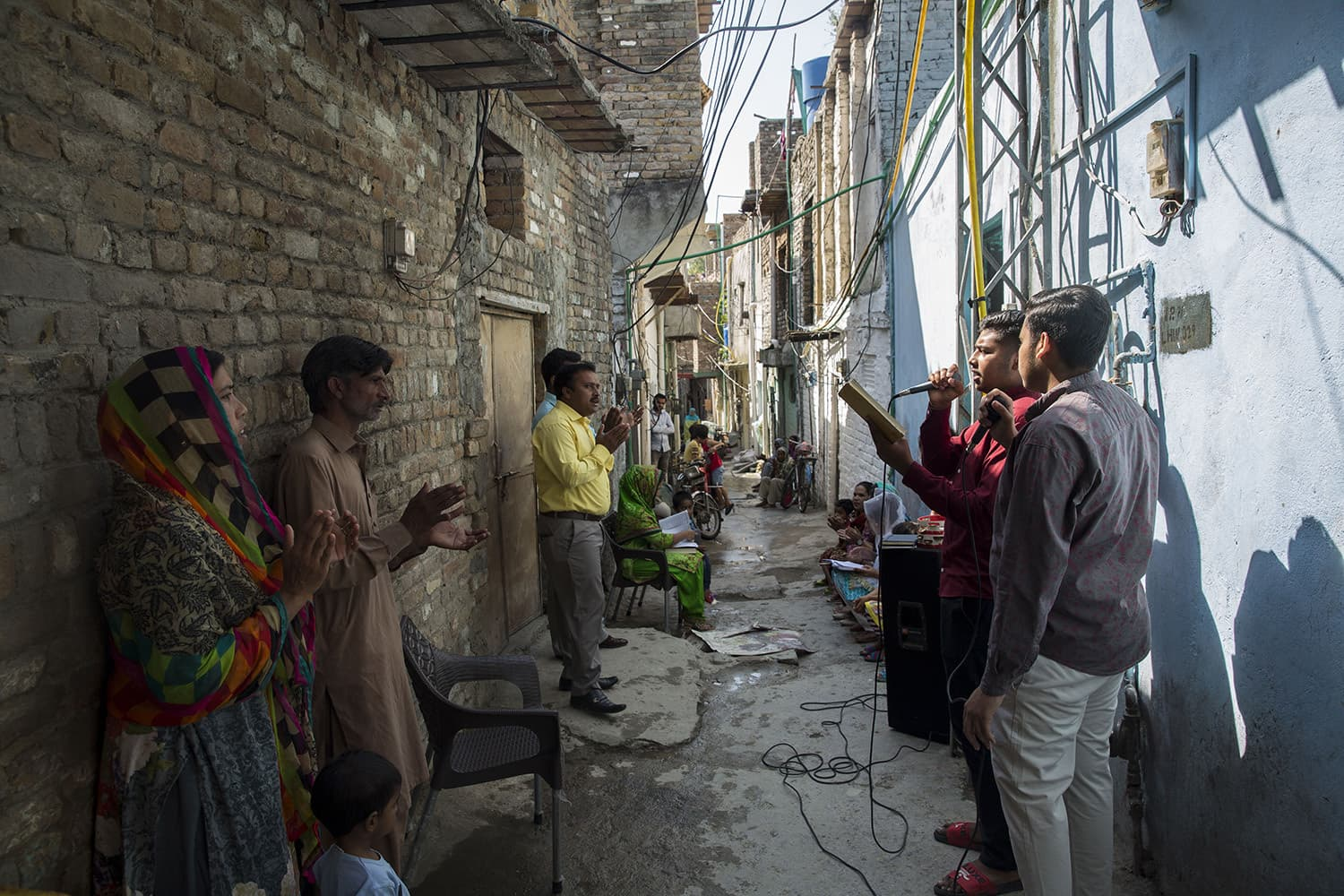 Arif Masih attends the Sunday mass in one of the streets in his neighbourhood along with his wife Ishrat and daughter Cynthia. Mosques in Pakistan remained open during the month of Ramazan but churches have remained closed until very recently. Photograph taken on May 10, 2020 in Islamabad.