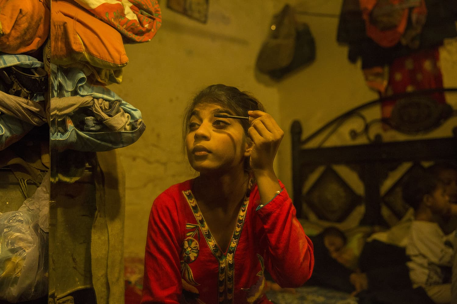 15-year-old Samantha puts on make-up as the family gets ready to go to the nearby park, April 29, 2020, in Islamabad.