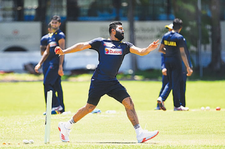 COLOMBO: Sri Lankan cricketer Lahiru Kumara bowls during a practice session at the Colombo Colts Cricket Stadium on Tuesday.—AFP