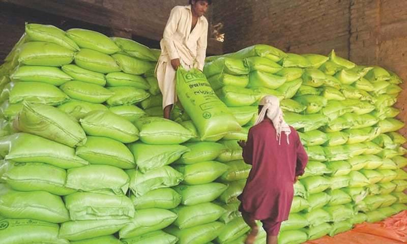 Due to reluctant purchasing by the farmers, substantial fertiliser stocks are stuck with the dealers. — Dawn/File