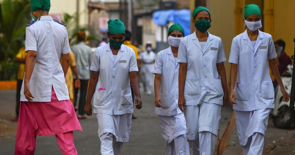 Nurses leave at the end of their shift at King Edward Memorial (KEM) hospital in Mumbai. — AFP