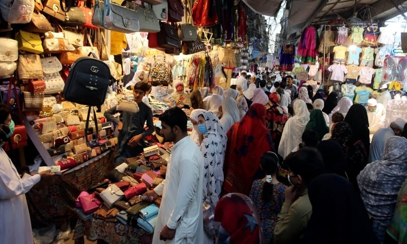 People shop in a market after the government relaxed the weeks-long lockdown in Peshawar on Monday, May 11. — AP/File