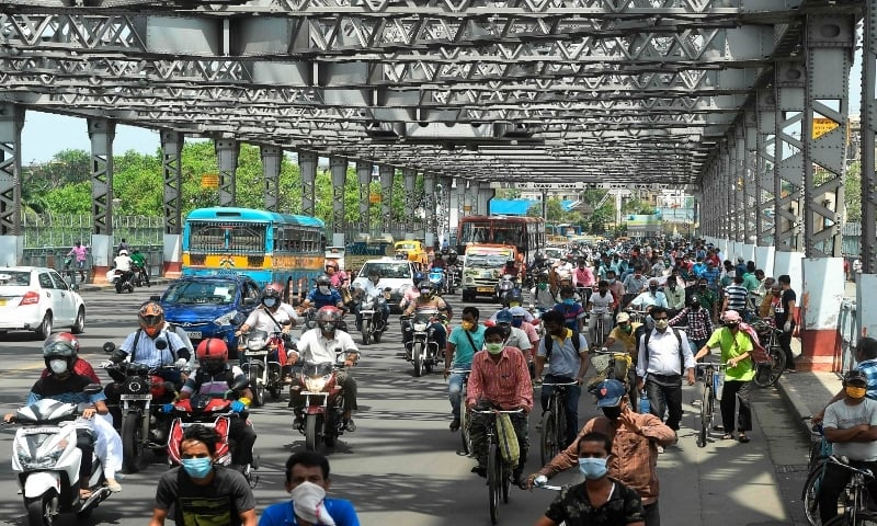 Commuters ride bicycles along the Howrah Bridge to go to work after the government eased a nationwide lockdown in Kolkata, India on June 5. — AFP