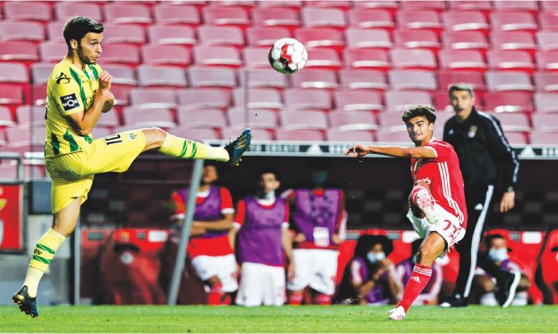 LISBON: Tondela's Pite (L) attempts to block a cross from Benfica's Jota during their Portuguese Primeira Liga match at the Estadio da Luz.—Reuters