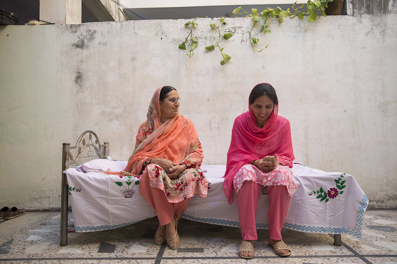 Nusrat Bibi, spends time with her mother Nurbano. Bibi and her brother are the only two members who earn an income in the family. Photograph taken on May 18, 2020 in Rawalpindi.