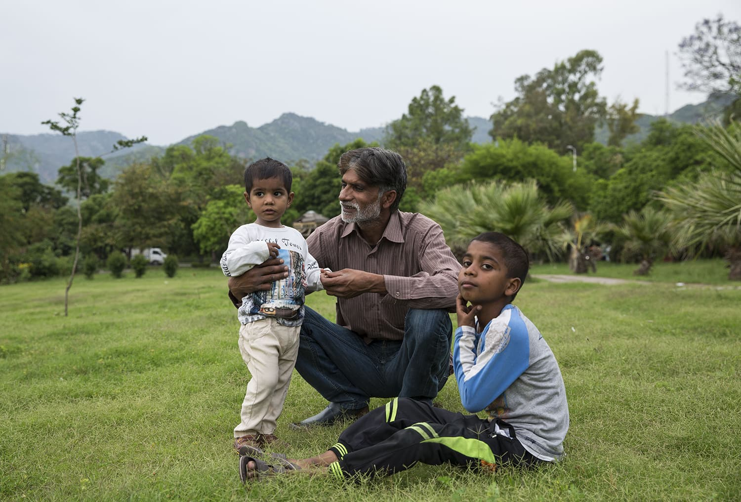 Arif Masih with his children Musa and Cynthia in the nearby park.