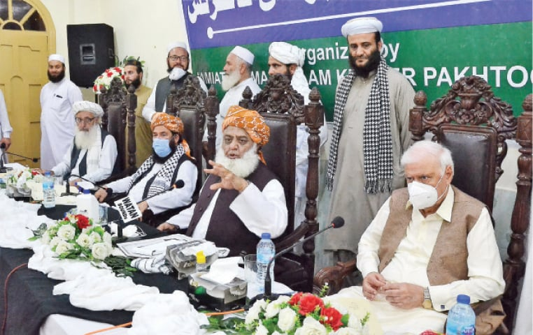 JUI-F chief Maulana Fazlur Rehman speaks at the multiparty conference in Peshawar on Saturday. — White Star