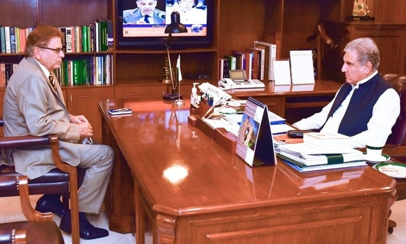 Foreign Minister Shah Mahmood Qureshi speaks to Mohammad Sadiq, Pakistan's special envoy for Afghanistan. — Photo courtesy Radio Pakistan