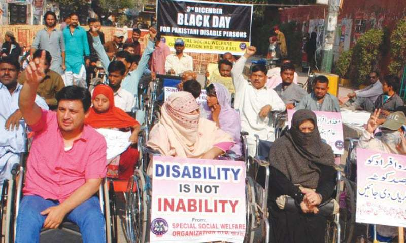 Rights activists have been protesting over government's move to abolish two per cent job quota for disabled people. — Dawn/File