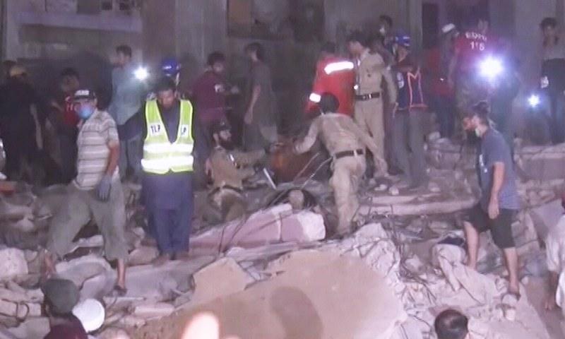 Rescue work under way at Lyari's liaquat Colony. — DawnNewsTV