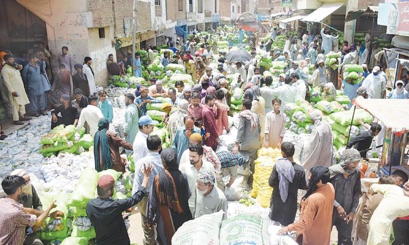 MANGOES being auctioned in old Sabzi Mandi, Hyderabad. —Umair Ali