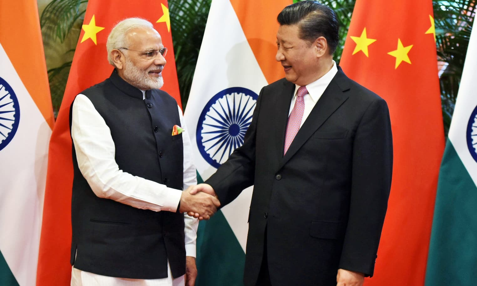 Chinese President Xi Jinping (R) shakes hands with Indian Prime Minister Narendra Modi during their visit at East Lake Guest House, in Wuhan, China, April 27, 2018. India's Press Information Bureau/Handout via REUTERS ATTENTION EDITORS - THIS PICTURE WAS PROVIDED BY A THIRD PARTY. NO RESALES. NO ARCHIVE
