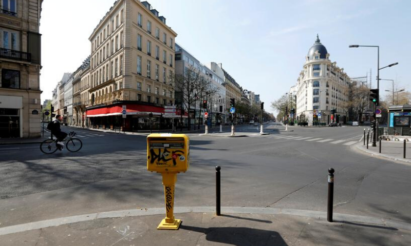 A cyclist rides on the deserted Grands Boulevards in Paris during the lockdown imposed to slow the spread of Covid-19 in France, March 27. — Reuters/File