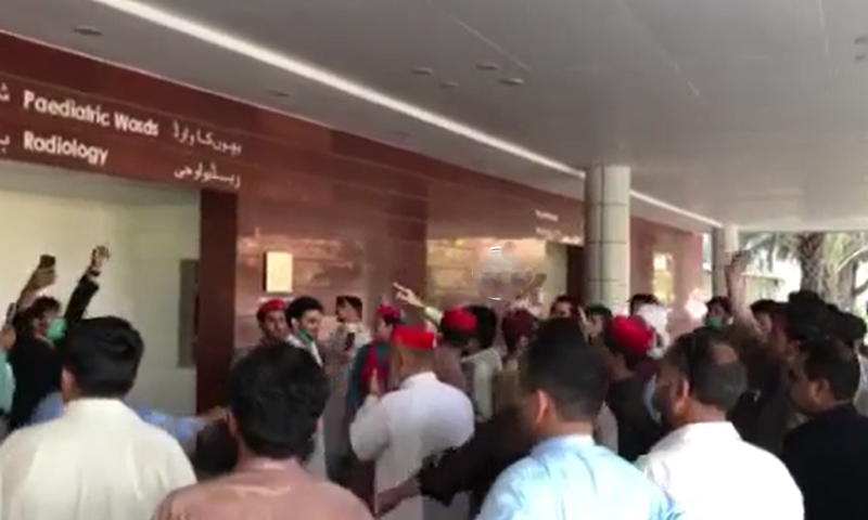 Protesters chant slogans at the Liaquat National Hospital on Tuesday. — Photo: screengrab