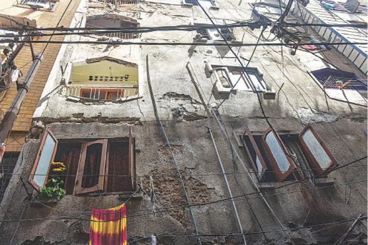 BUILDINGS like this with bits having already fallen in Lyari may cause more tragedies if the authorities do not take care of them soon enough. —Fahim Siddiqi / White Star