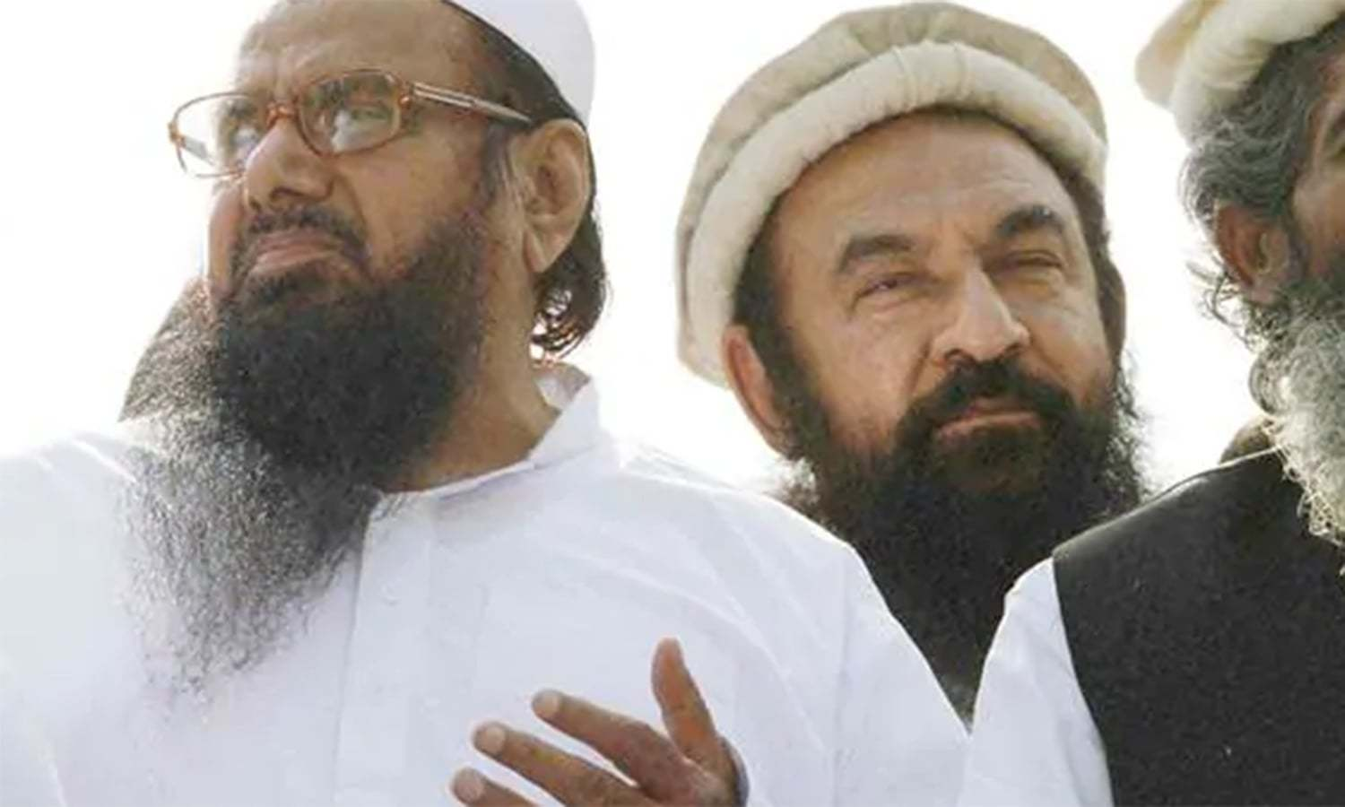 Strict security measures taken in and outside the court premises before the appearance of the JuD leaders. — AFP/File