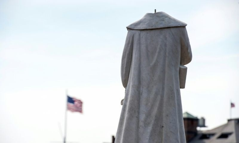 A decapitated statue of Columbus is seen at Christopher Columbus Park in Boston, Massachusetts on June 10. — AFP
