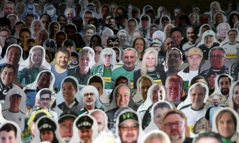 Cardboard cut-outs and Zoom parties: the new normal for Premier League fans