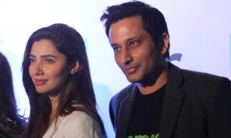 Khan pictured with Salim Karim