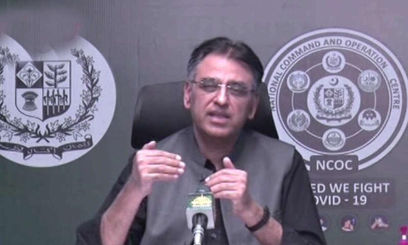 Head of National Command and Operations Centre (NCOC) Asad Umar gestures during a press conference. — DawnNewsTV