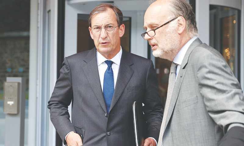 Paris: Nicolas Bazire (left), former French prime minister Edouard Balladur's former cabinet chief of staff and presidential campaign manager, leaves the courthouse on Monday, after the hearing in the financial aspect of the so-called 'Karachi affair' case.—AFP