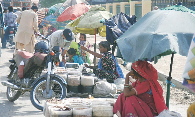 THESE women selling dried fruit in front of Empress Market on Tuesday may face a 'smart lockdown' now a few days after returning to work following months of restrictions.—Online