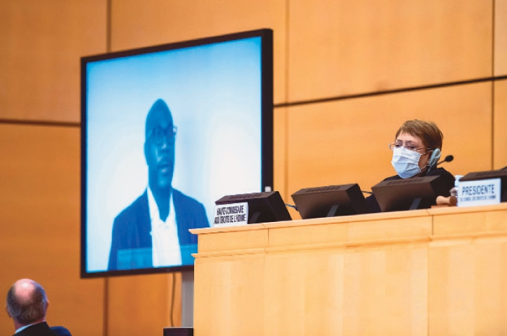 """UN High Commissioner for Human Rights Michelle Bachelet (right) looks on next to a TV screen showing George Floyd's brother, Philonise Floyd speaking via video message during an urgent debate on """"systemic racism"""" in the United States and beyond at the Human Rights Council on Wednesday.—AFP"""