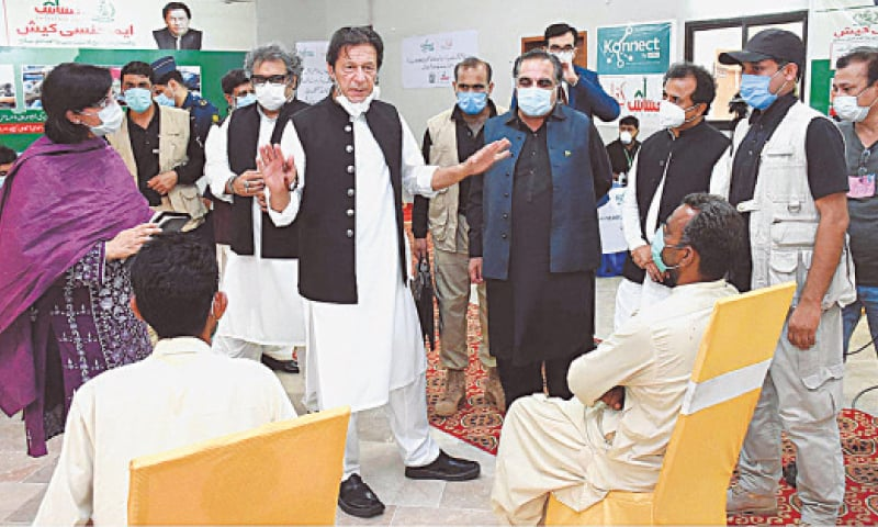 LARKANA: Prime Minister Imran Khan interacting with beneficiaries during his visit to an Ehsaas centre set up at the Police Training Centre on Wednesday.—APP