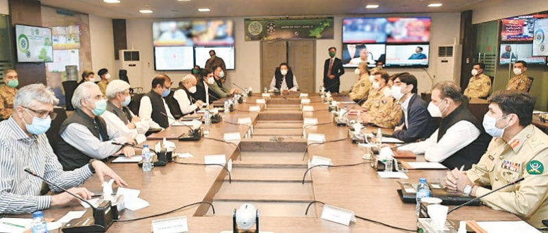 ISLAMABAD: Prime Minister Imran Khan presides over a meeting during his visit to the National Command and  Operation Centre on Thursday.