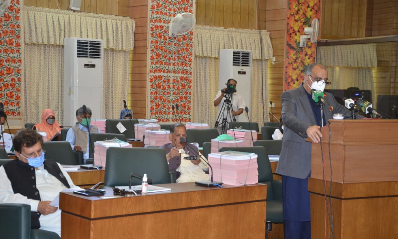 MUZAFFARABAD: AJK Minister for Finance Dr Najeeb Naqi presenting budget for 2020-21 in the assembly on Thursday. PM Raja Farooq Haider (extreme left) is also seen. Photo by author