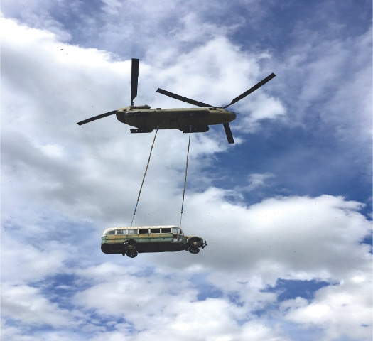 "HEALY (Alaska, US): An army CH-47 Chinook helicopter carries the bus made famous by the ""Into the Wild"" book and movie during its relocation.—Reuters"