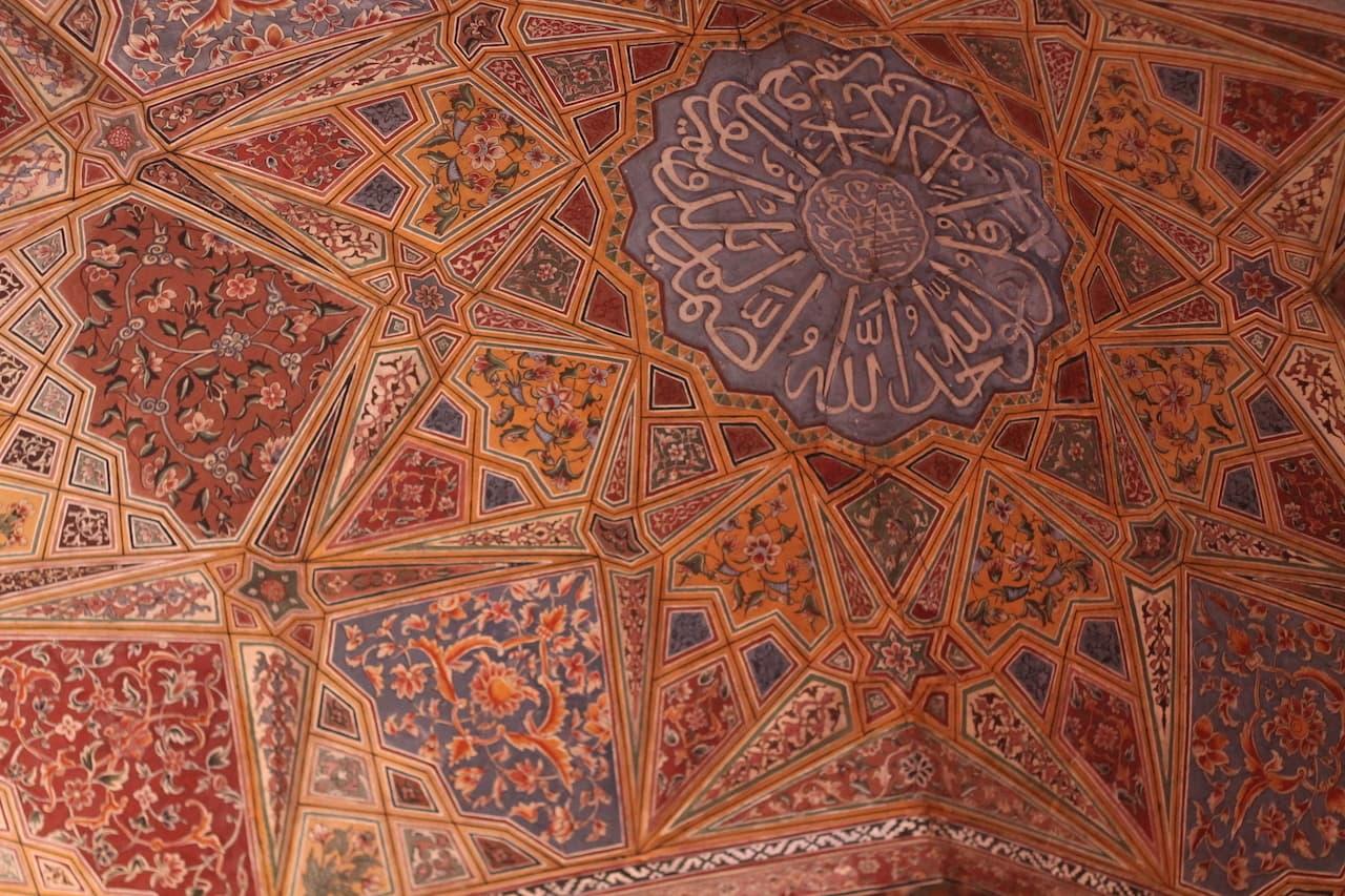 Arabic text on detailed frescoes of Masjid Wazir Khan | Image by Onaiza Drabu