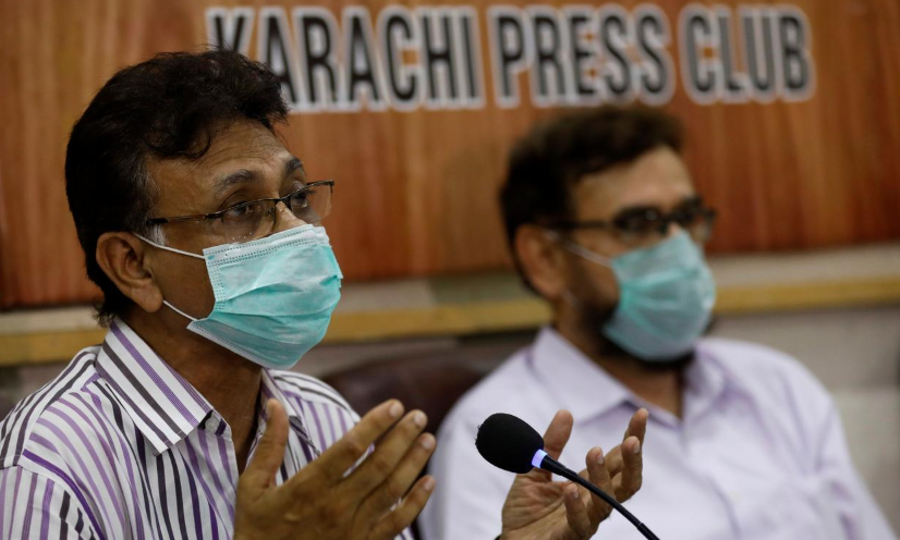 Dr Qaiser Sajjad, secretary-general of the Pakistan Medical Association (PMA) along with other doctors speaks during a news conference to appeal to the government for a strict implementation of the lockdown to stem the spread of Covid-19, Karachi. — Reuters/File