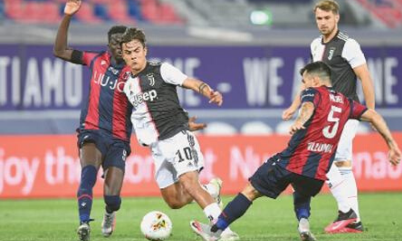 BOLOGNA: Paulo Dybala (second L) of Juventus in action with Bologna players Musa Barrow (L) and Gary Medel during their Serie A match at Stadio Renato Dall'Ara.— Reuters
