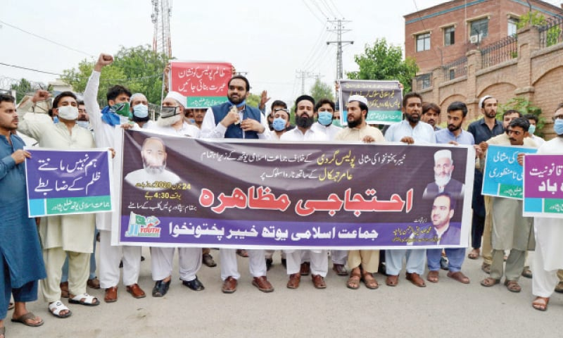 Jamaat-i-Islami workers stage a protest outside Peshawar Press Club on Wednesday against torture of youth by police. — White Star