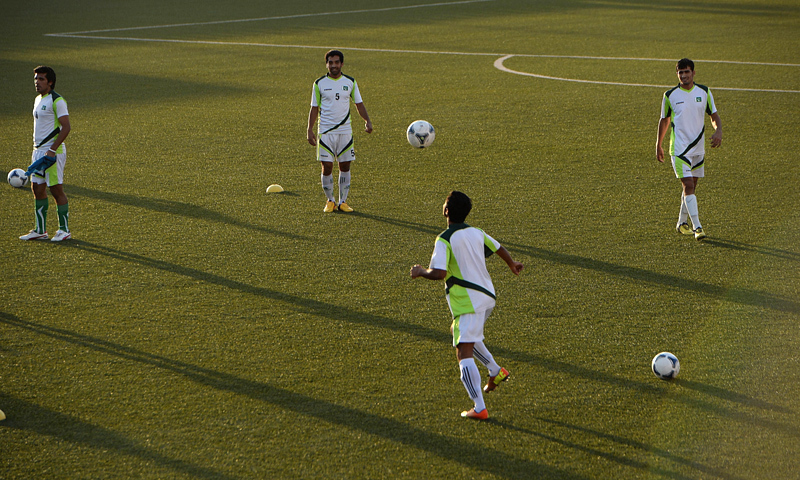 Pakistan football team players practice during a training session. — AFP/File