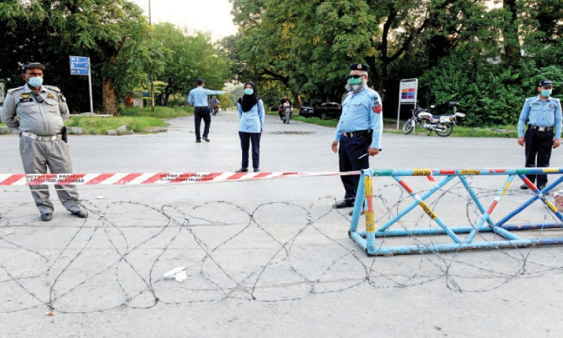 The capital administration has placed barbed wire at the entrance to G-7/2. The sub-sector was sealed on Wednesday after a surge in Covid-19 cases among residents. — Photo by Mohammad Asim