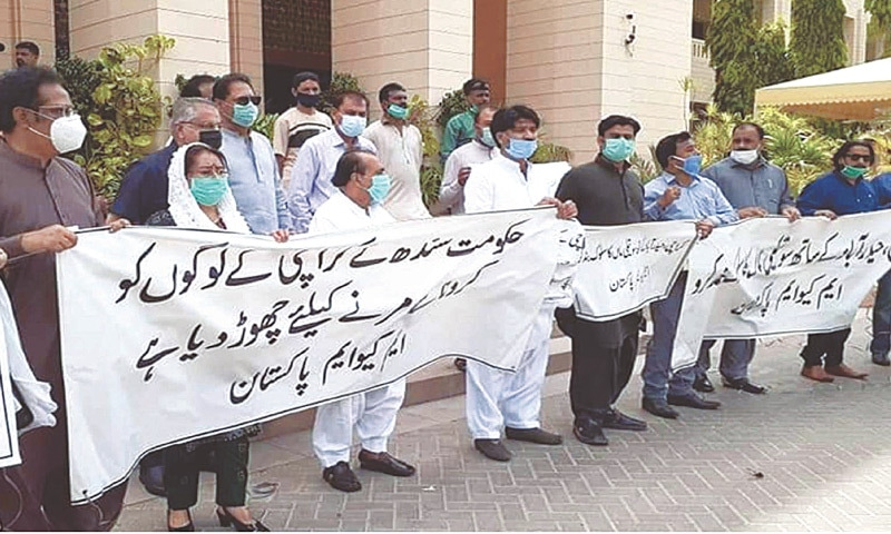 MQM lawmakers hold a protest outside the Sindh Assembly building on Thursday.—PPI