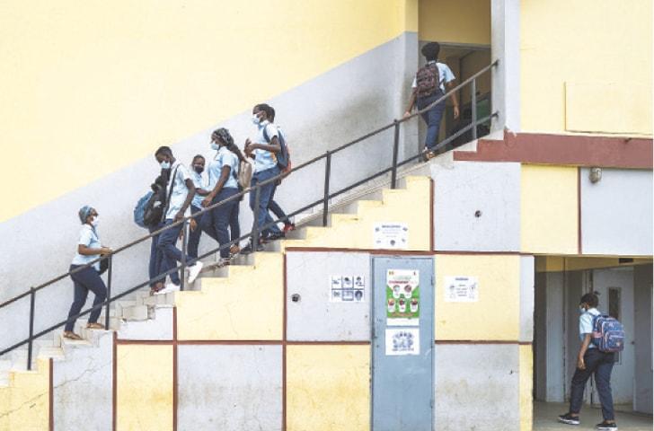 DAKAR: Students wear masks at the Sacre Coeur college on Thursday.—AP