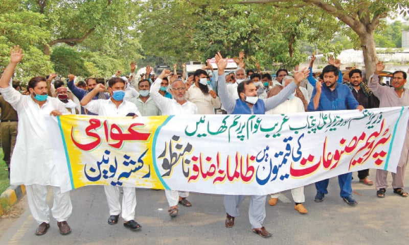 RICKSHAW drivers protest in Johar Town against record increase in oil prices. — White Star