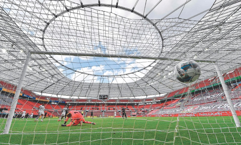 LEVERKUSEN: Mainz's goalkeeper Florian Mueller fails to stop the goal scored by Bayer Leverkusen's Kevin Volland during the Bundesliga fixture at BayArena on Saturday. — AFP